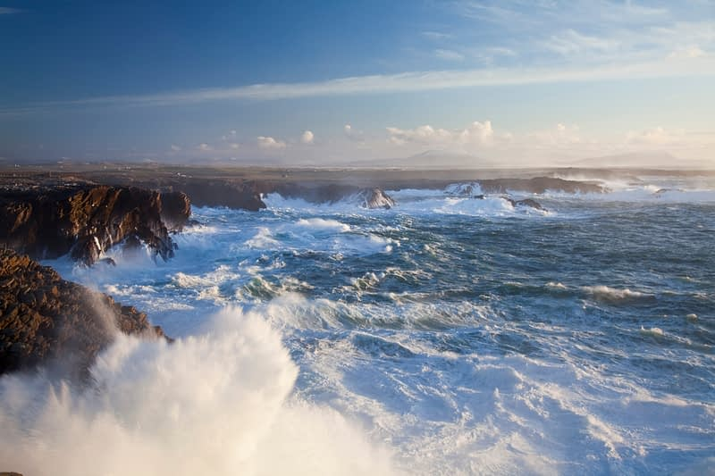 Storm waves crashing against the cliffs of Belmullet, Co Mayo, Ireland.