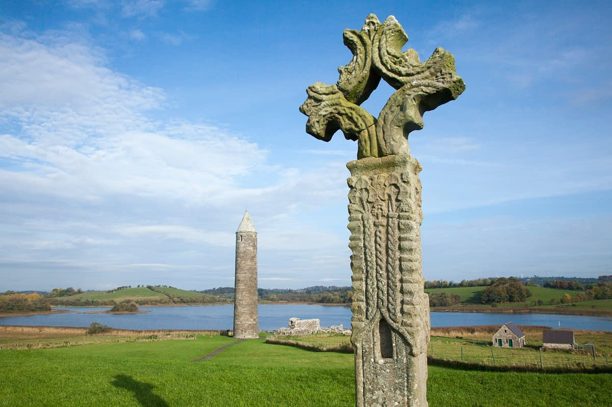 High cross and round tower, Devenish Island, Lower Lough Erne, County Fermanagh, Northern Ireland.