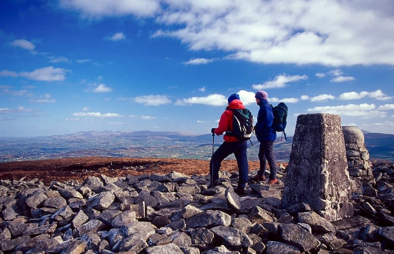 Walkers at the summit of Slieve Gullion, Co Armagh, Northern Ireland.