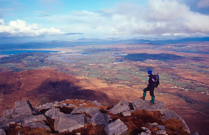 Walker on the summit of Muckish Mountain, County Donegal, Ireland.