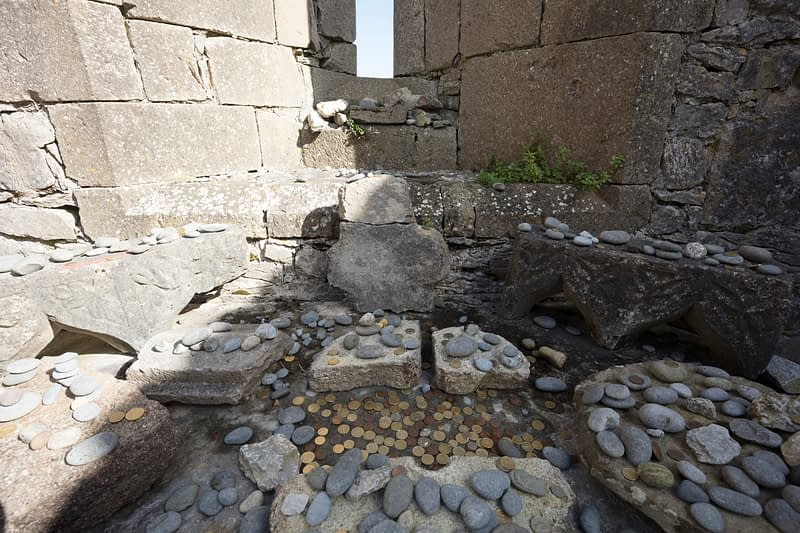 Religious offerings in The Seven Churches, Inishmore, Aran Islands, County Galway, Ireland.