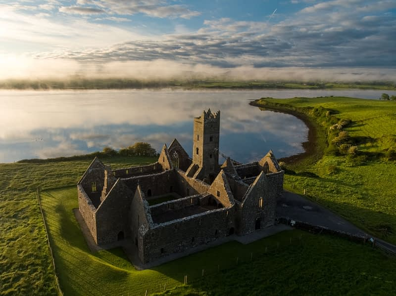 Rosserk Abbey and morning mist along the River Moy, County Mayo, Ireland.