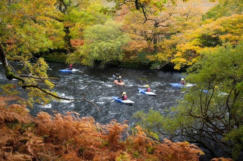 Kayakers on the Owenmore River, County Mayo, Ireland.