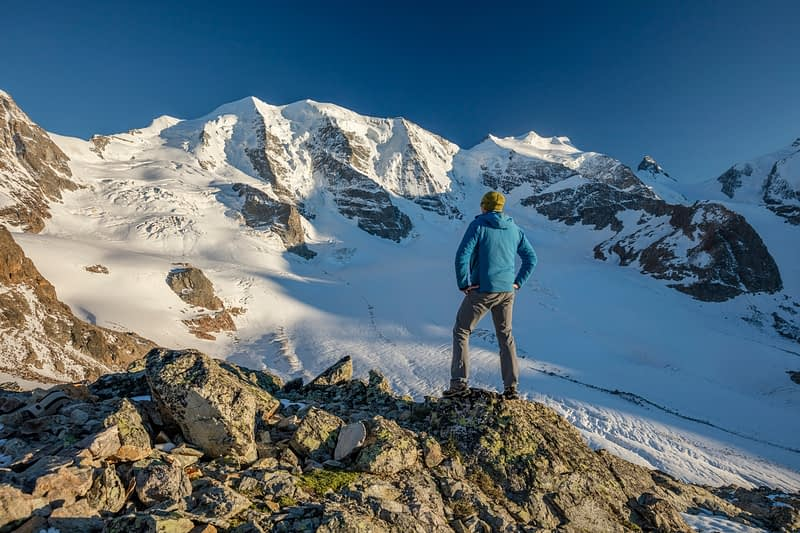 Hiker beneath Piz Palu, Diavolezza, Berniner Alps, Graubunden, Switzerland.