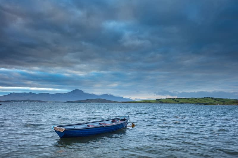 Fishing boat moored in Clew Bay, with Croagh Patrick behind. County Mayo, Ireland.