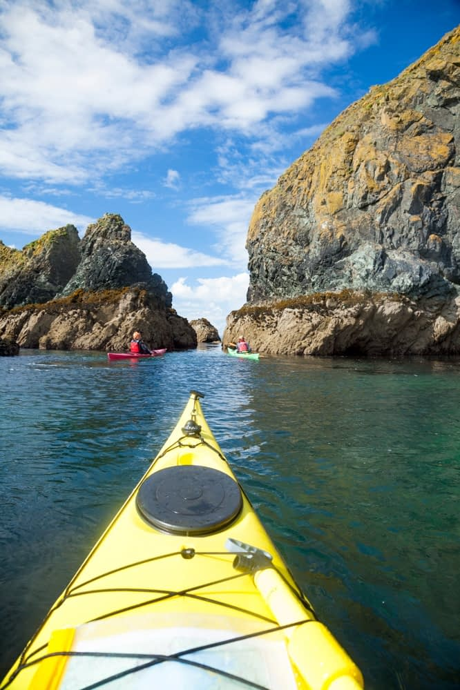 Sea kayaking along the Copper Coast, County Waterford, Ireland.