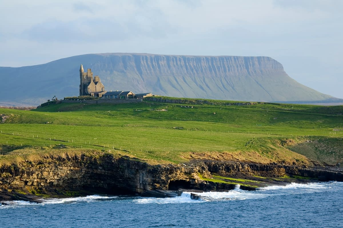 Classie Bawn Castle and Benbulbin, Mullaghmore, Co Sligo, Ireland.