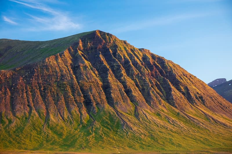Erosion gullies define a mountain near Pingeyri, Westfjords, Iceland.