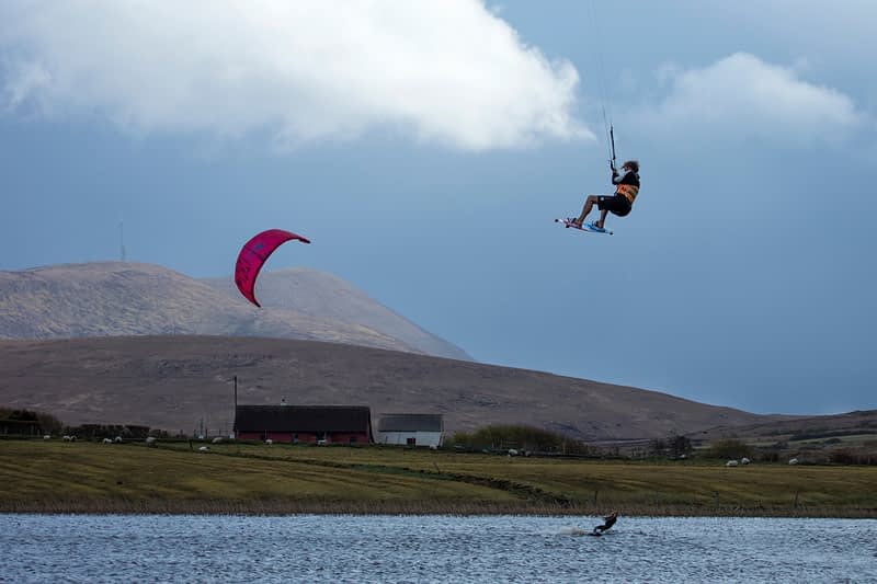 Francois Colussi and Sophie Mathews kitesurfing, Keel Lough, Achill Island, County Mayo, Ireland.