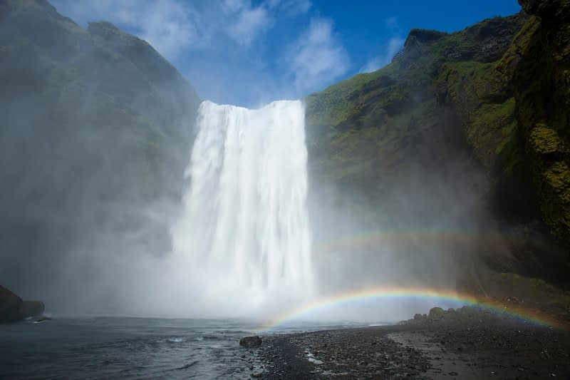 Double rainbow beneath 60m-high Skogafoss waterfall, Skogar, Sudhurland, Iceland.
