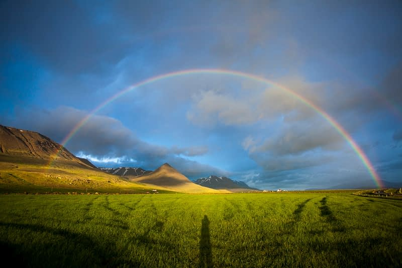 Evening rainbow over the Heradsvotn valley, Skagafordur, Nordhurland Vestra, Iceland.