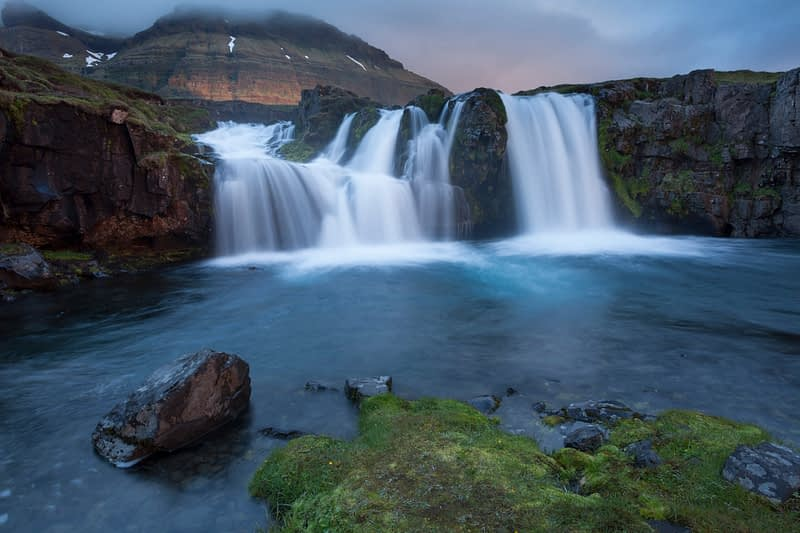 Early morning at Kirkjufell waterfall, Grundarfjordur, Snaefellsnes Peninsula, Vesturland, Iceland.