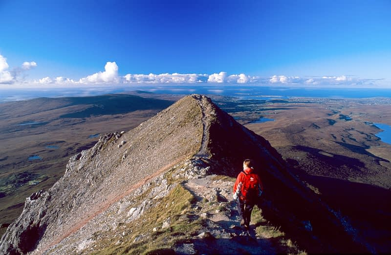 Walker nearing the summit of Errigal Mountain, Co Donegal, Ireland.