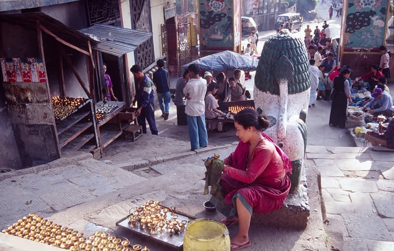 A candle seller prepares for the festival of Diwali, Kathmandu, Nepal.