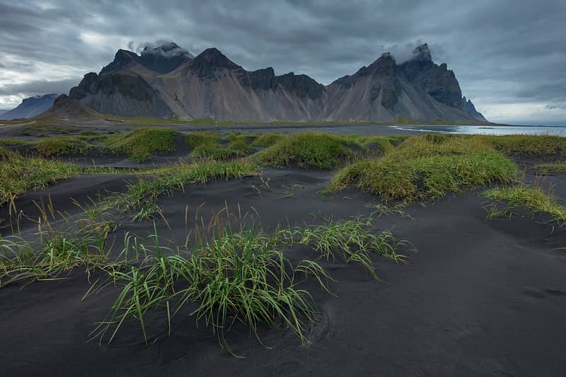 Vestrahorn Mountain rises above the black sand beach at Stokksnes. Hofn, south east Iceland.