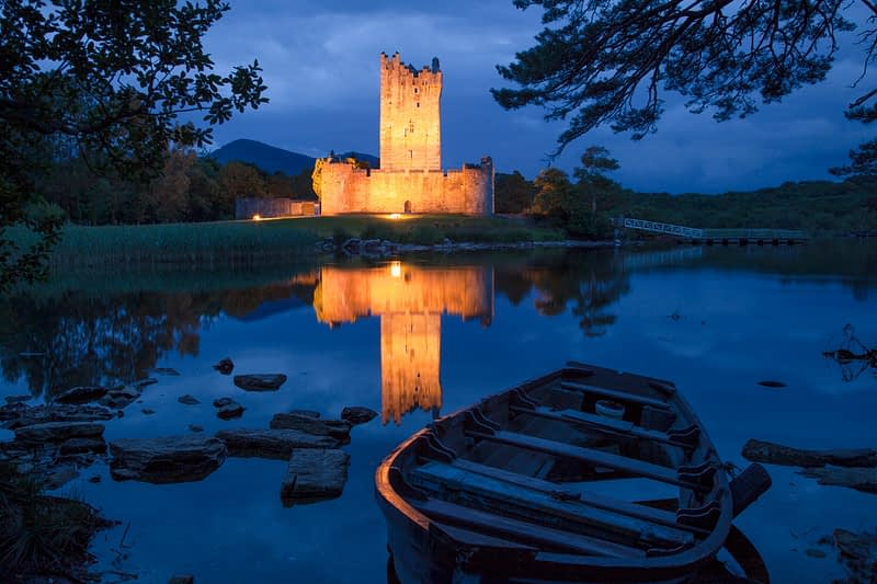 Ross Castle illuminated at dusk, Killarney, County Kerry, Ireland.