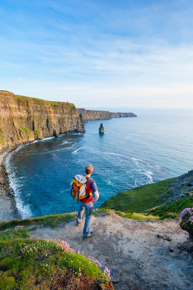 Walker at the Cliffs of Moher, County Clare, Ireland.