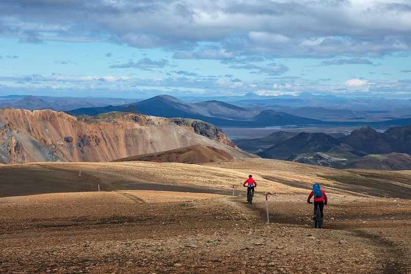 Mountain bikers on the Laugavegur trail  near Landmannalaugar. Central Highlands, Sudhurland, Iceland.