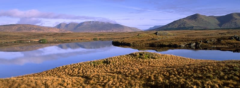 The Sheefry Hills reflected in Lough Fee, Connemara, Co Mayo, Ireland.
