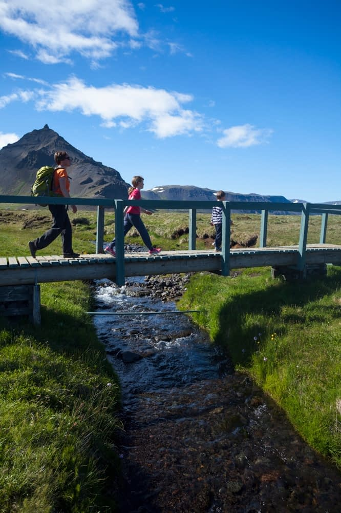 Family hiking the Hellnar-Arnarstapi coastal path, Snaefellsnes Peninsula, Vesturland, Iceland.