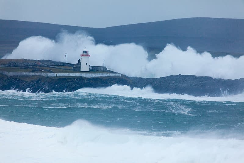 Storm waves crash above Broadhaven Lighthouse, Gubbacashel Point, Belmullet, County Mayo, Ireland.