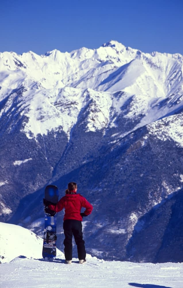 Snowboarder in the Cirque du Lis, Cauterets, French Pyrenees, France.