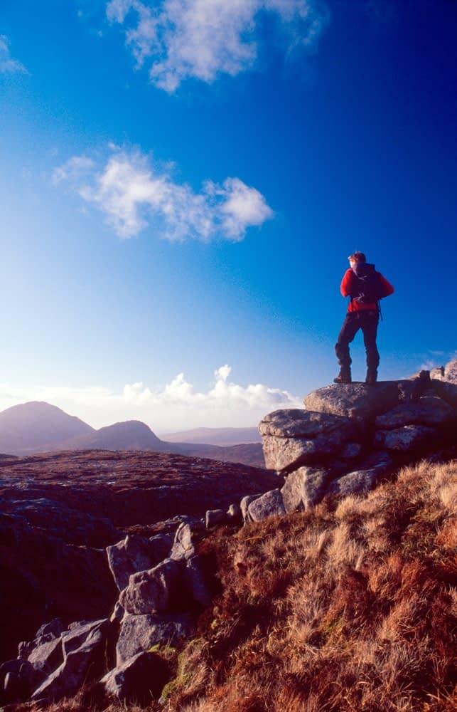 Walker looking towards Errigal from Dooish, Derryveagh Mountains, Co Donegal, Ireland.