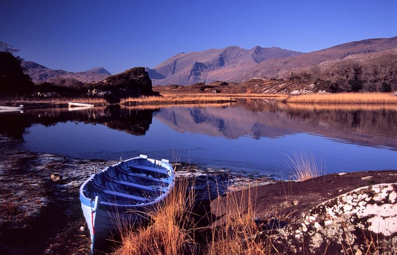 Winter fishing boat beside Upper Lough, Killarney National Park, Co Kerry, Ireland.