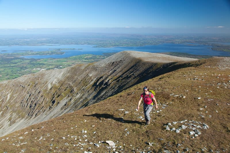Walker approaching the summit of Nephin, County Mayo, Ireland.