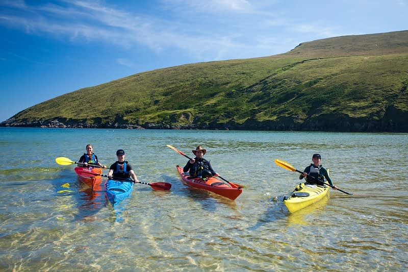 Sea kayakers in Portacloy Bay, Co Mayo, Ireland.