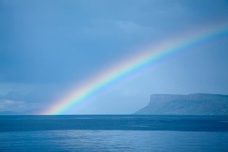 Rainbow across Fair Head, County Antrim, Northern Ireland.