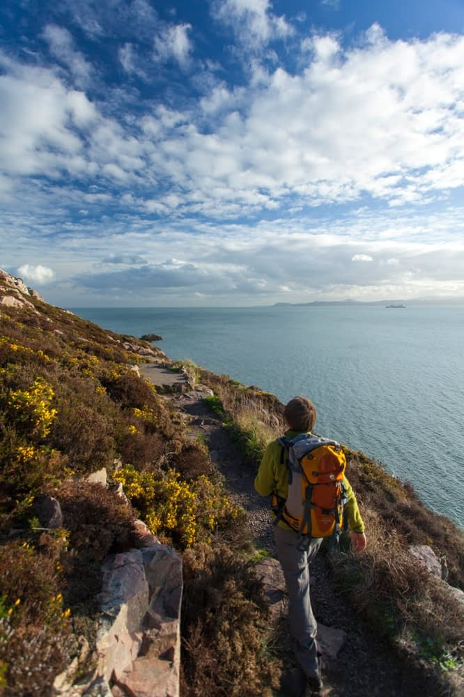 Walker near Red Rock, Howth Coatal Path, County Dublin, Ireland.
