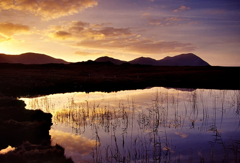 Dawn reflections in Lough Fee, Connemara, Co Galway, Ireland.