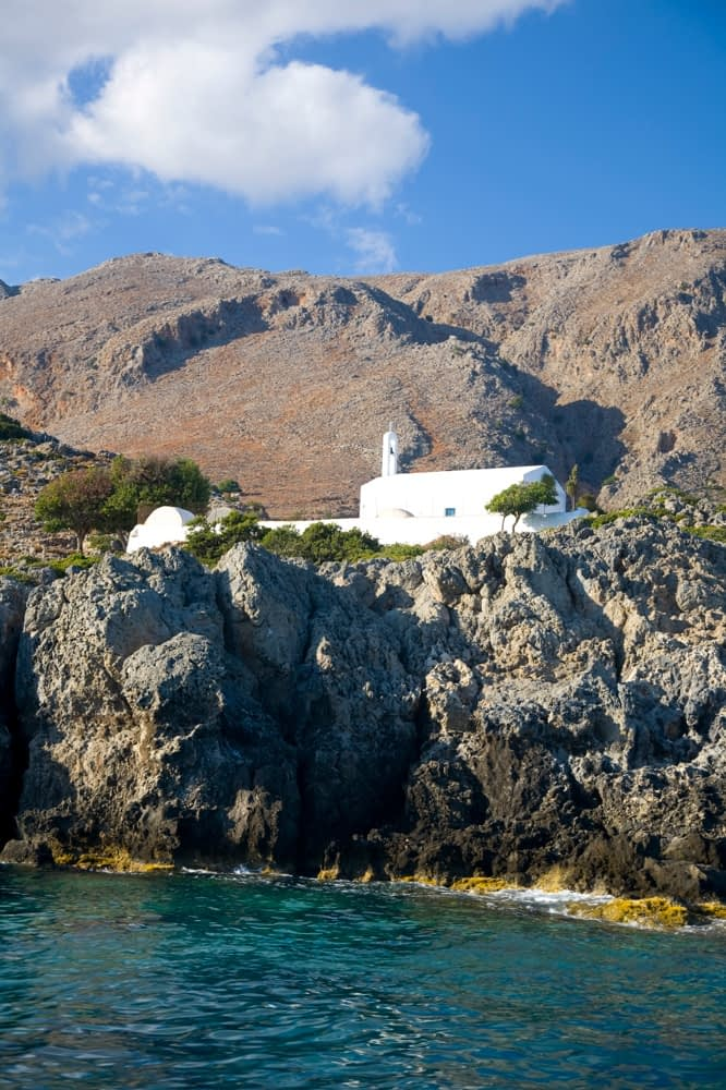 Traditional church beneath the White Mountains, Loutro, Crete, Greece.