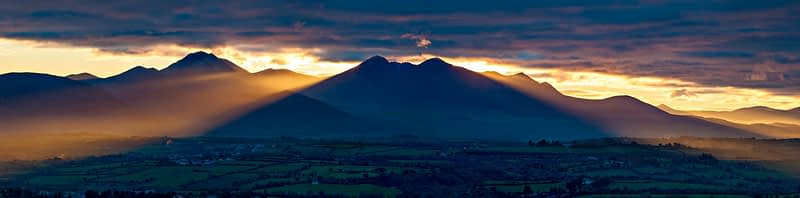 Crepuscular rays over the Macgillycuddy's Reeks, County Kerry, Ireland.