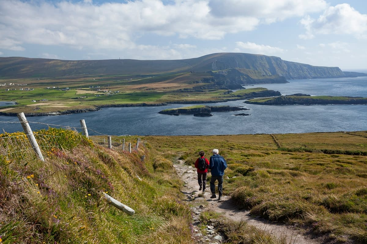 Walkers on the trail at Bray Head, Valentia Island, County Kerry, Ireland.