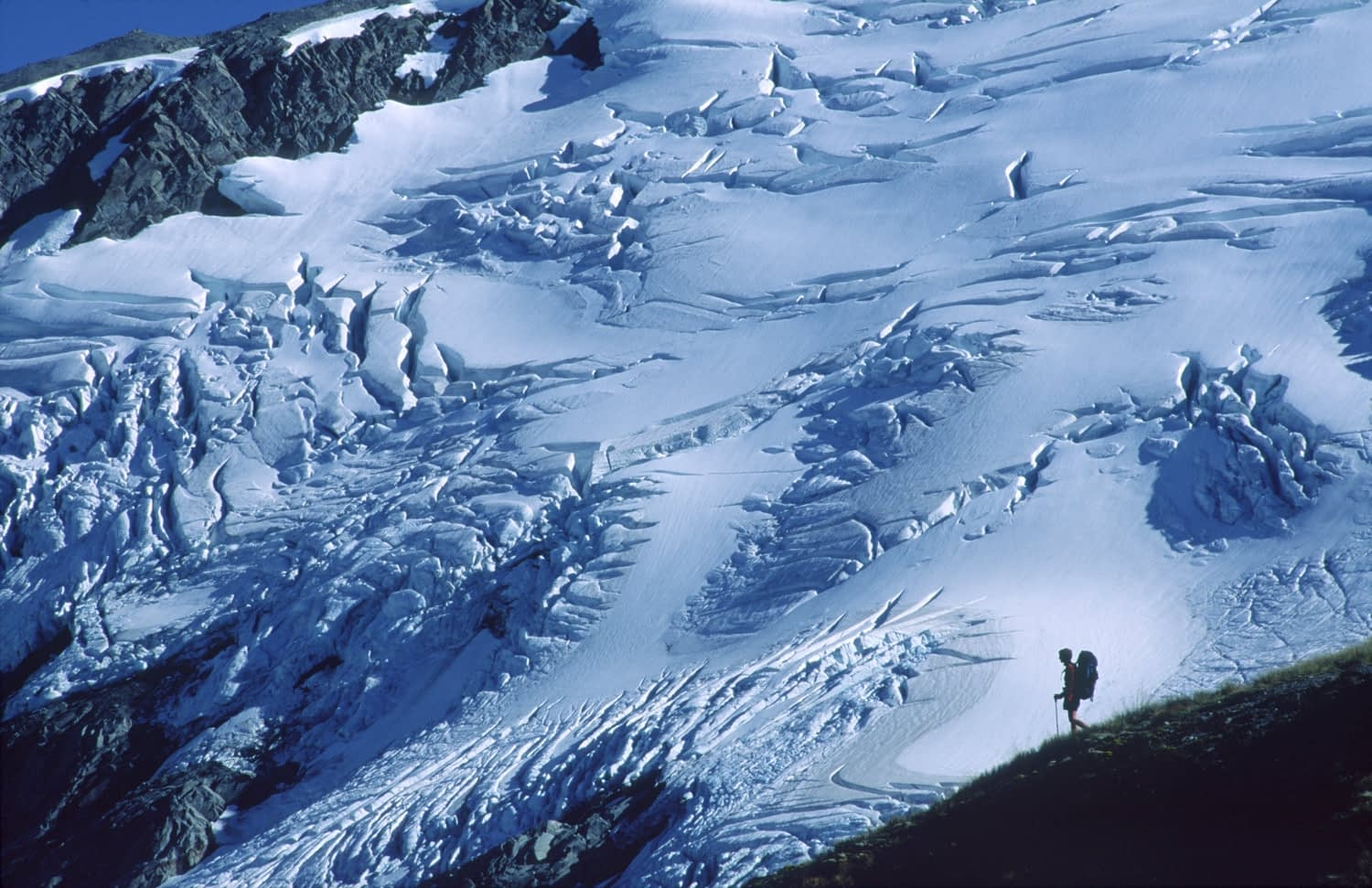 Trekker on Cascade Saddle above the Dart Glacier, Southern Alps, New Zealand