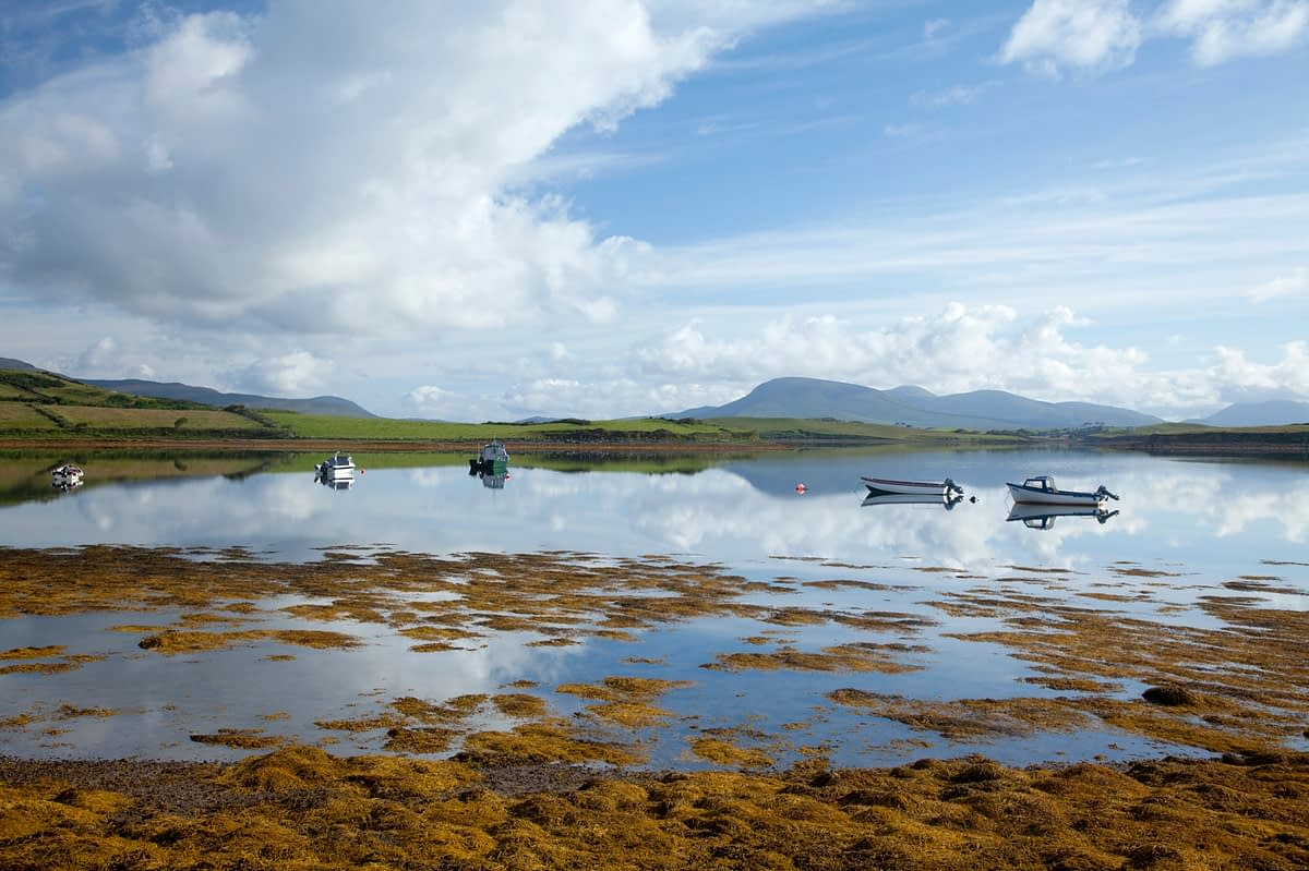 Small boats moored in Clew Bay, Co Mayo, Ireland.