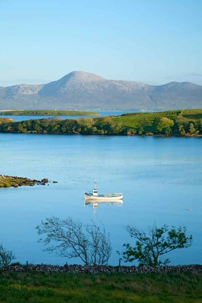 Boat in Clew Bay beneath Croagh Patrick, Co Mayo, Ireland.