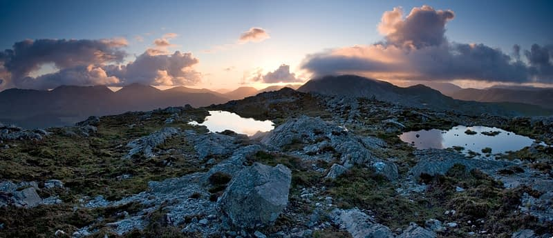 Evening pools on the summit of Knocknahillion, Maumturk Mountains, Co Mayo, Ireland.