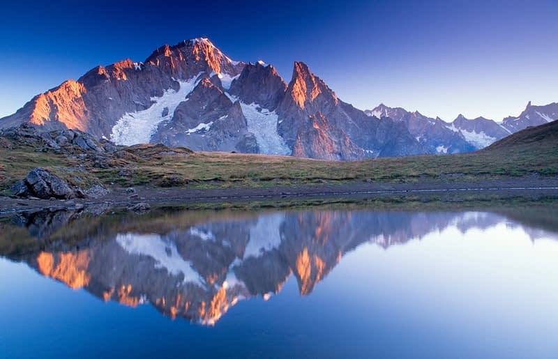 Dawn reflection of Mont Blanc, Val Veni, Tour of Mont Blanc, Italian Alps, Italy.