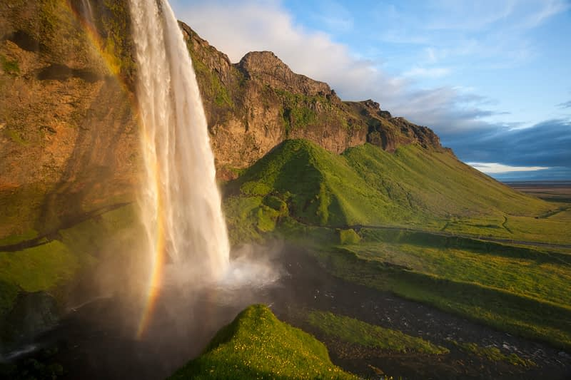 Evening rainbow at Seljalandsfoss waterfall, Sudhurland, Iceland.