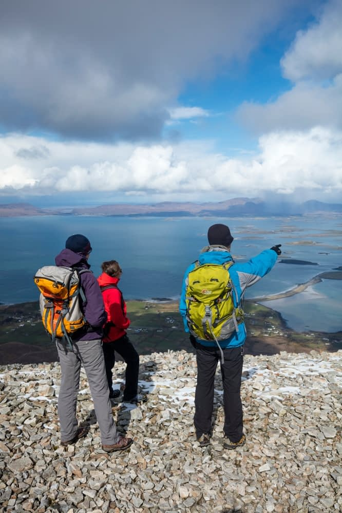 Hikers at the summit of Croagh Patrick, County Mayo, Ireland.