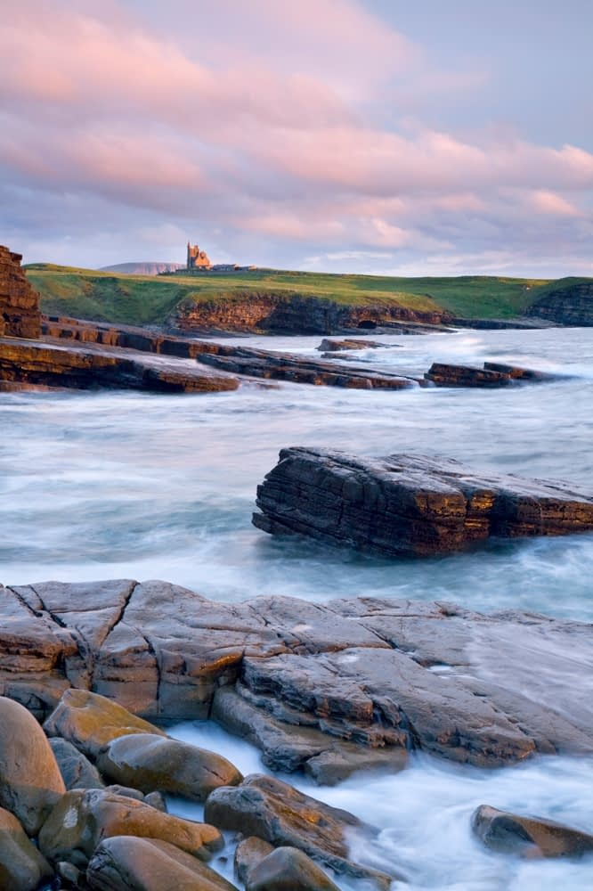 Classie Bawn Castle and Mullaghmore Head at sunset, Co Sligo, Ireland