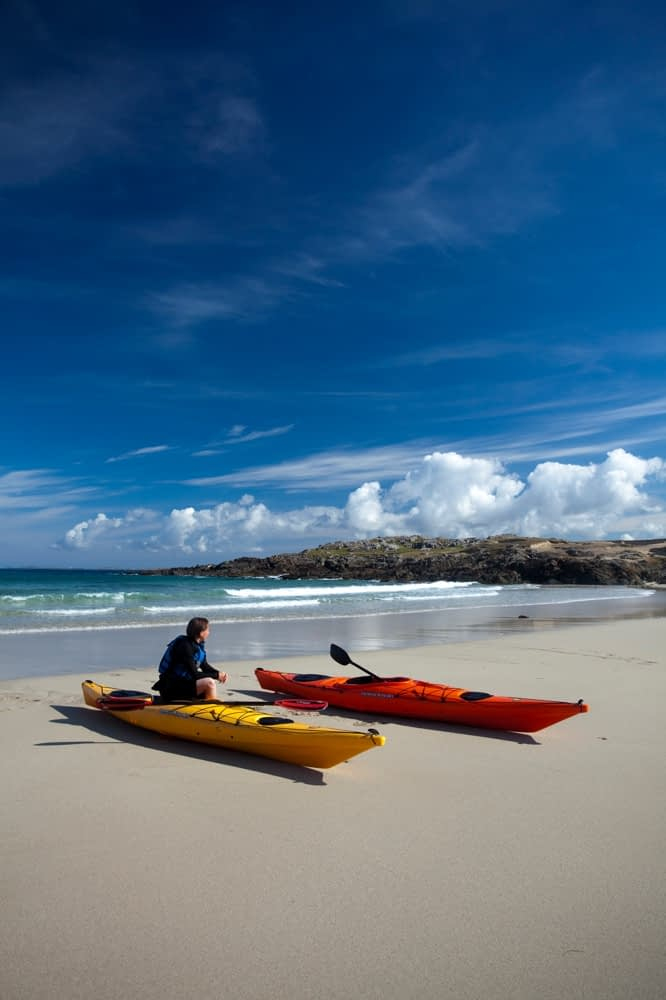 Sea kayaker resting in False Bay, Mannin, Connemara, Co Galway, Ireland.