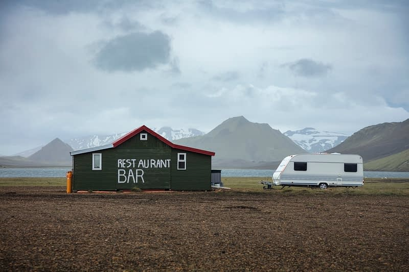 Remote restaurant and caravan beside the FI mountain hut at Alftavatn, along the Laugavegur hiking trail. Central Highlands, Sudhurland, Iceland.