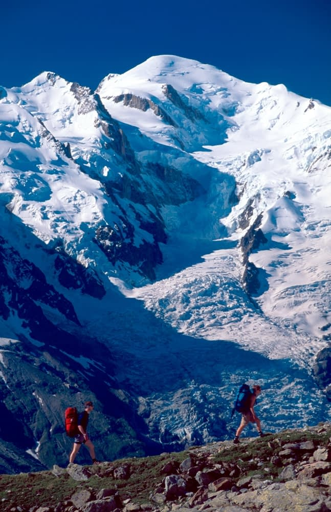 Walkers on the Balcon Sud beneath Mt Blanc, Chamonix Valley, French Alps, France.