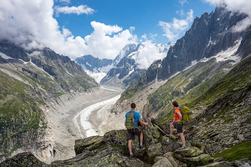 Hikers above Mer de Glace glacier, Chamonix Valley, French Alps, France.