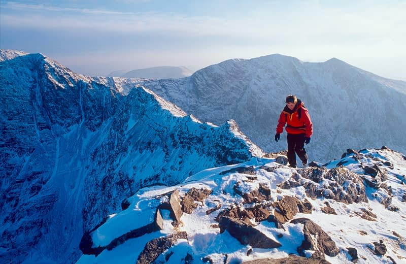 Winter walker on the Beenkeragh Ridge, MacGillycuddy's Reeks, Co Kerry, Ireland.