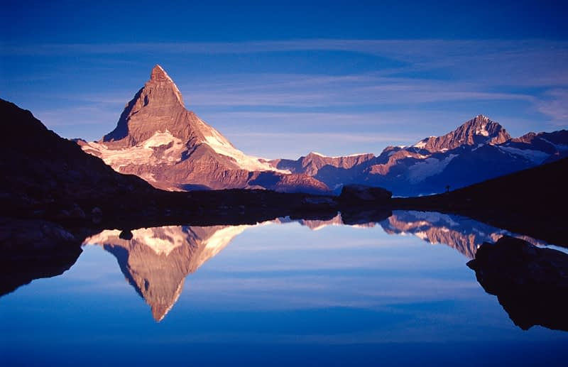The Matterhorn reflected in the Riffelsee at dawn, Valais, Swiss Alps, Switzerland.